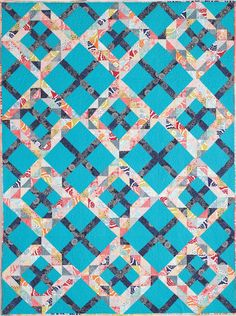 CROSSING WAVES by Krista Robbins: This trendy design is based on the traditional Ocean Waves quilt block. A sea-blue background grid gives it an updated look. Bonus instructions are available for making this throw quilt in both twin and queen sizes.