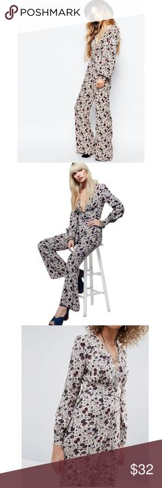 Free People Floral Jumpsuit ✨NWT✨ Jumpsuit by Free People Lightweight printed fabric Plunge neck Fitted empire band Flared leg Button-keyhole back Regular fit - true to size Machine wash 52% Viscose, 48% Rayon Free People Dresses Long Sleeve