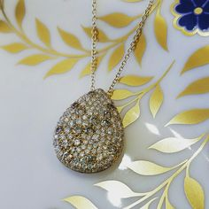 This pendant is encrusted with champagne diamonds. Isn't it absolutely sumptuous!? 😍 #schomburgs #jewelers #shoplocal #familybusiness #columbusga #finejewelry #lux #eyecandy #instajewelry #champagne #diamonds #are #forever #royalcrownderby #blueandgold