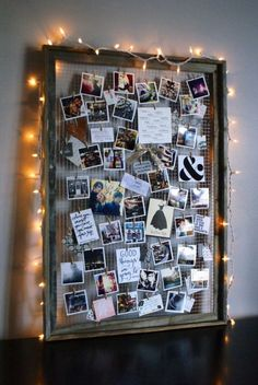 By removing the glass interior and adding wire, you can elevate an old frame into a beautifully crafted photo collage-esque display. Bonus: Add string lights around the frame to create a soft glow. Get the tutorial at Anastasia Co.   - CountryLiving.com