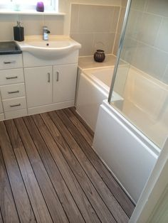 Bathroom ideas: This white bathroom furniture looks great alongside the wooden laminate flooring by Fiona from Annan Bathroom Design Small, Bathroom Layout, Modern Bathroom, Bathroom Designs, Gray Bathrooms, Small Bathrooms, Glass Bathroom, Minimalist Bathroom, Country Bathrooms
