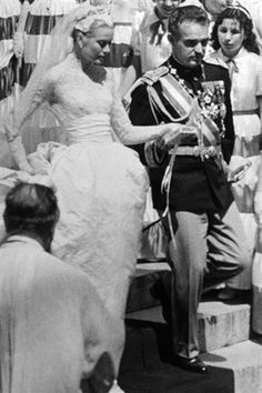 Prince Rainier leads his film star bride Grace Kelly from Monaco Cathedral on April 19 1956 (PA)
