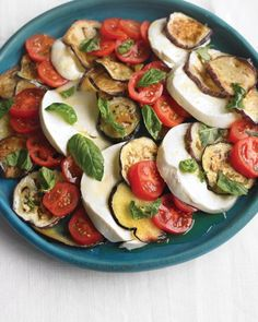 Eggplant, Tomato, and Mozzarella Salad | Add grilled eggplant to the classic caprese salad of fresh mozzarella, tomatoes, and basil for a summer vegetable extravaganza. Enjoy it as a starter or a side, or serve it with crusty Italian bread as a vegetarian main dish.