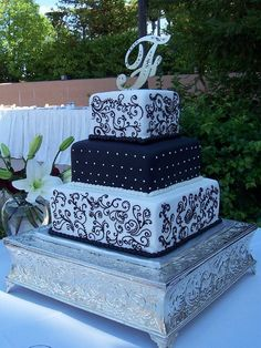 Black and white square wedding cake with scrollwork