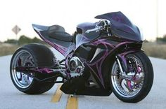 Black, Purple and just one bad custom bike. Would so love to own a street fighter like this.