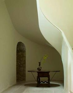 Axel Vervoordt - <3 the tiny hint of stone in the hallway and that stairwell is to die for!
