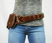 """A trendy new way to carry your necessities. Perfect for outdoor events, concerts, horseback, bikers or other hands free activities. Loose the bag and get """"hip""""."""