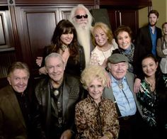 Seated are Bill Anderson, Jim Ed Brown, Brenda Lee, Roy Clark, Crystal Gayle. Standing are Deborah Allen, William Lee Golden, Tanya Tucker, Jan Howard.