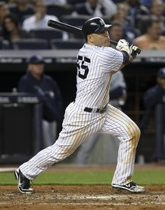 GAME 54: Tuesday, June 5, 2012 - New York Yankees' Russell Martin hits a grand slam during the fourth inning of a baseball game against the Tampa Bay Rays at Yankee Stadium in New York. (AP Photo/Seth Wenig)