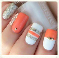 Painted orange nails.