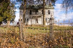 Love this abandoned home in St. Louis County, Missouri. The fence and gate are incredible.
