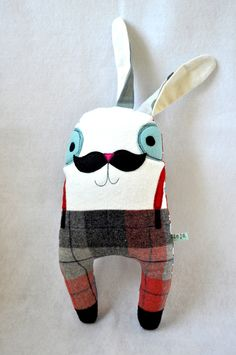 Bunny cuddly toy with moustache