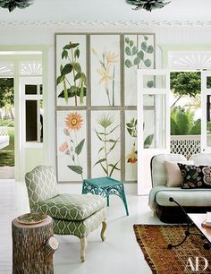 Botanical art by Natural Curiosities hangs in Casa Guava's living room | archdigest.com