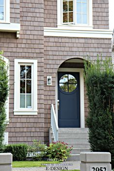 Front door similar to Benjamin Moore Hale Navy with pink, purple taupe stained shingles on exterior with off-white trim. PHoto via Kylie M INteriors E-design