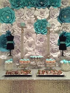 Gorgeous paper flower backdrop at a Tiffany & Co quinceañera party! See more party ideas at CatchMyParty.com!