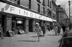 18 April 1963 Exterior of Findlaters grocer, Upper O'Connell Street, Dublin. Dublin Street, Dublin City, Old Pictures, Old Photos, Liverpool Docks, Grafton Street, Ireland Homes, Photo Engraving, Emerald Isle