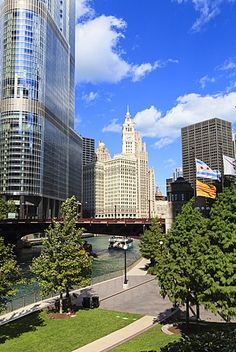 Chicago River Walk and towers including Trump Tower and the Wrigley Building…