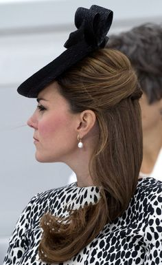 Catherine Duchess of Cambridge, aka Kate Middleton, at the naming of the Royal Princess cruise ship for Princess Cruises in Southampton. She is wearing the Dalmatian Print Mac coat by Hobbs, hat by Sylvia Fletcher for Lock and Company, black pumps, and she's carrying a 2011 Alexander McQueen Wicca Mini-Satchel. 06/13/13