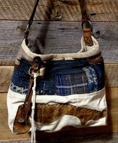 My own J. Augur hobo bag I carry every day.  Navajo, Japanese indigo, WWII canvas, vintage saddle leather applique and vintage braided leather strap.