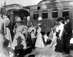 Virginia and Truckee Railroad Passenger Car No. 3 with man, women, and children on platform in foreground, possibly in Virginia City, 1885. -- Special Collections Department, University of Nevada, Reno Libraries