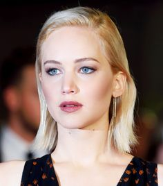 Jennifer Lawrence's wears taupe lipstick and a subtle, shimmery eye look with gold, bronze, and purple shadows