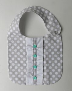 Items similar to Baby Girl Ruffle Bib in Purple Polkadots with Green Buttons and White Ruffle on Etsy