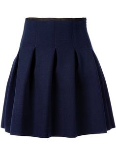 Box pleated skirt with closed top to create a more tapered waist.  It would be pretty to sew something like this in a wool fabric for fall.