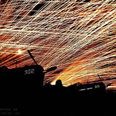 """the_ww2_memoirs A lace-work of tracers fills the sky during a raid by enemy Japanese aircraft on the newly captured airfield of Yontan Airfield, Okinawa, April, 1945. The aircraft in the photograph are Marine F4U Corsairs belonging to the """"Hells Belle's"""" squadron. This photograph is one of my all time favorites from the war and when I saw this I knew I had to post it. In early April 1945 multiple divisions from both the US Army and Marines stormed the beaches of Okinawa with little…"""