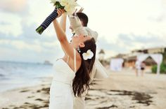 Newlyweds celebrating their nuptials on the beach of the Riviera Maya.  Mexico wedding photographers Del Sol Photography