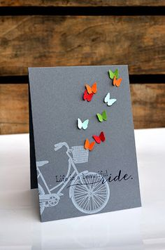 card by Jess Witty... love the white on gray with the little butterfly pops of color!