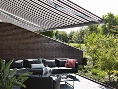 Cool seating area - enjoy the sun without glare and heat with large Luxaflex® Awning.
