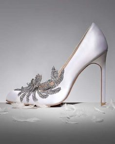 """Satin pump features crystal-beaded vine applique angled across vamp and outer side. Almond toe. 4"""" covered heel. """"Swan"""" is made in Italy."""