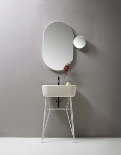 Float & Gravity is a minimalist line of bathroom mirrors created by London-based designer Samuel Wilkinson for EX.T. The new line of bathroom mirrors is inspired by universal space and the force of gravity. Float is a large round mirror that appears to have two geometric objects floating within its surface. The mirror is a playful contemporary interpretation of the classic dressing room vanity mirror. Towards the bottom edge is a rounded semi-circular black marble shelf, at the top a…