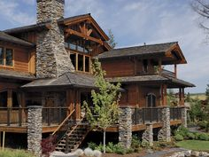 """Cedar siding, props, posts, beams, and board and batten plus cultured stone accents = great """"lodge"""" look"""