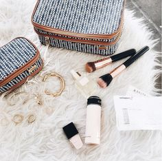 Don't pack just any makeup bag. Pack a cute one.