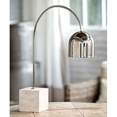 Travertine Base Dome Task Lamp Regina Andrew Design redefines contemporary style. With an artist's eye, they skillfully mix modern with rustic; elegant with casual; romantic with relaxed. #reginaandrewdesign #homedecor #design #interiors #interiorhomescapes #interiorhomescapes.com