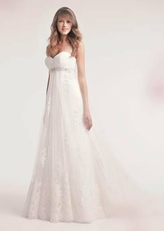 An empire waist gown with delicate embroidery and a jeweled ...