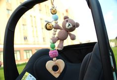 A personal favorite from my Etsy shop https://www.etsy.com/listing/290778671/bear-bees-car-seat-toy-pram-toy-toy-for