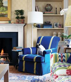 Sommers brightened the client's club chairs in the family room with Kravet's Versailles blue velvet and celery-green strap work.   - HouseBeautiful.com