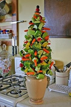 Want a healthy appetizer for the holidays?  Create this edible Christmas tree with a foam cone, a pot, toothpicks and veggies