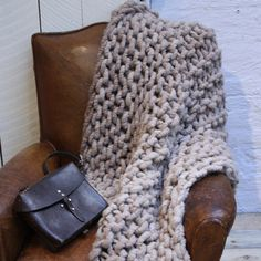 This soft and beautiful hand-knit throw from Loopy Mango is made from 100 percent alpaca wool. A lustrous and silky natural fiber, alpaca is similar to sheep's wool, but warmer, not prickly and bears no lanolin, which makes it hypoallergenic. This cozy, textured blanket will quickly become your favorite textile to wrap up in.  Available as kit or ready-made.