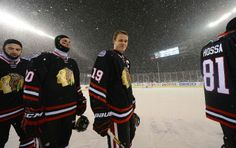CHICAGO, IL - MARCH 01: Captain Jonathan Toews #19 of the Chicago Blackhawks stands at the blue line with his teammates as snow falls on the rink prior to the 2014 NHL Stadium Series game at Soldier Field on March 1, 2014 in Chicago, Illinois. (Photo by Brian Babineau/NHLI via Getty Images)