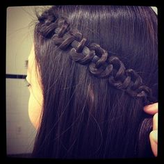 You braid your hair and then hold onto the middle strand and push up the other two. so simple. And cute