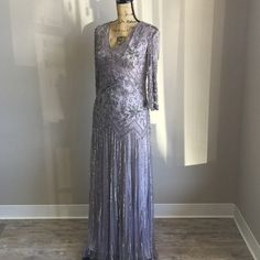 HAND BEADED New Years Eve Dress Worn once, Crystal hand beaded through out. Shimmery pastel gray. Scoop back and front, 3/4 sleeves Dresses Maxi