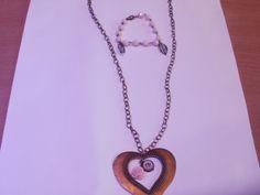 bronzen ketting met roosje en cabouchon met bijbhorende armband
