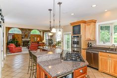 166 Feldspar Rdg, Glastonbury, CT, Connecticut 06033.  Spacious eat in gourmet kitchen opens to expansive family room with vaulted ceiling and stone fireplace.