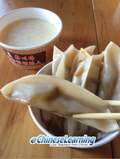 What is this Chinese food called? find out more at eChineseLearning.com 饺子(jiǎozi) and gruel 粥(zhōu)