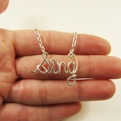 Sing Necklace Silver Word Necklace Personalized Necklace Music Choir Glee Musician Wire Wrap Jewelry Gifts under 20 by deannewatsonjewelry on Etsy https://www.etsy.com/listing/122060886/sing-necklace-silver-word-necklace