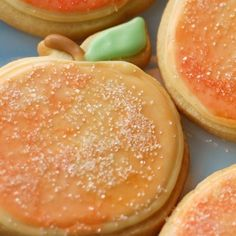 Peach sugar cookies.  Royal icing, painted with colored water and sprinkled with sanding sugar