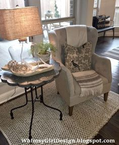 I love the texture the glass lamp, faux antlers, jute wrapped glass globes and rustic wooden tray from Home Goods bring into our neutral reading nook. {Sponsored Pin}